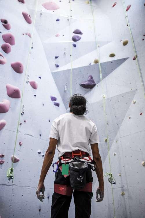 indoors rock climber wall climb exercise