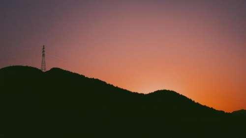 sunset dusk silhouette mountains hills