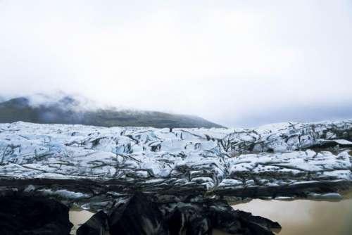 mountain rocks snow winter water