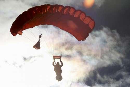 parachute sky clouds dark silhouette