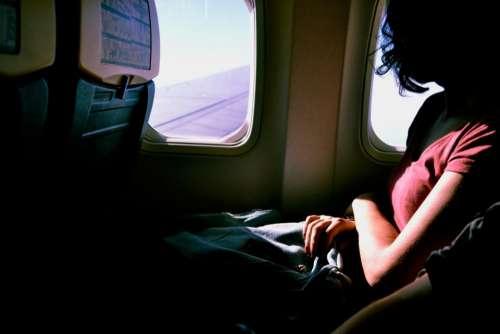 airplane flight seats people woman
