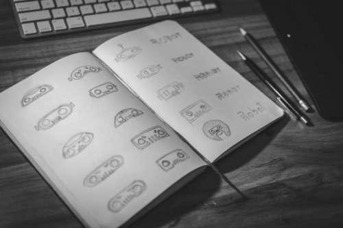 designer logo sketch notebook desk