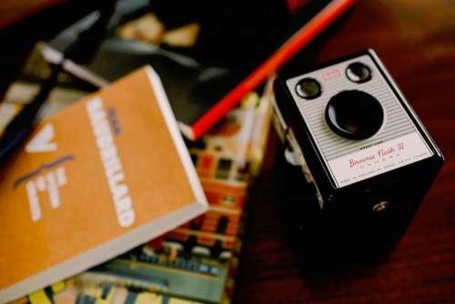 desk books brownie flash camera