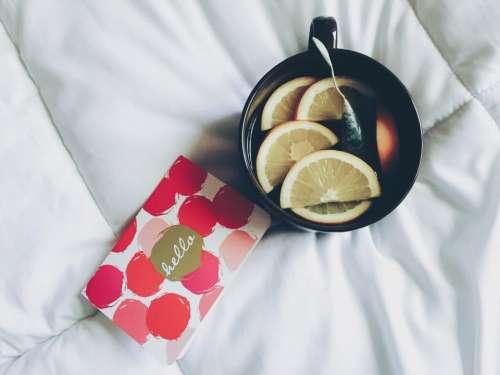 black cup mug lemon fruit