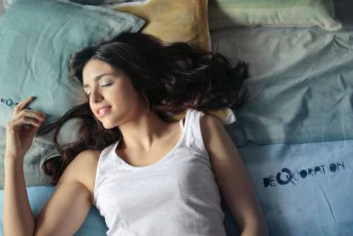 pretty woman sleeping bed smile