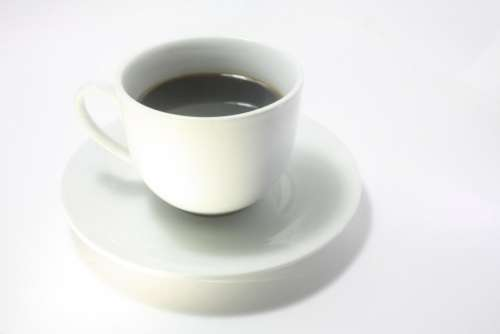 white cup saucer black coffee