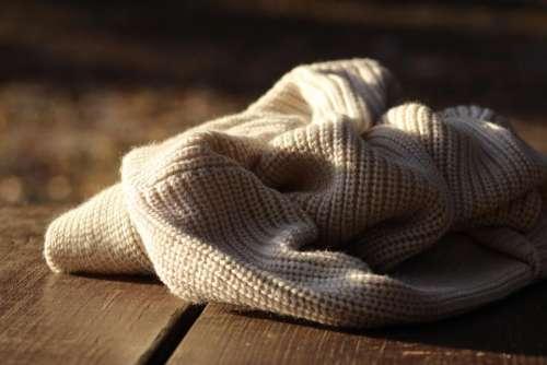 bokeh blur clothing sweater wooden floor