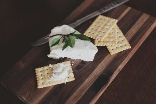 cheese crackers snack food cutting board