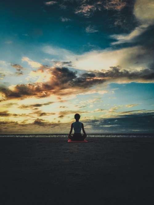 woman beach yoga sunset evening