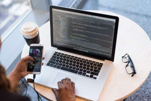woman developer laptop macbook mac