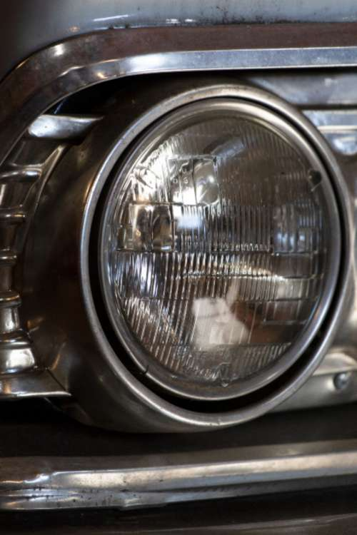 vintage car headlight close up automotive