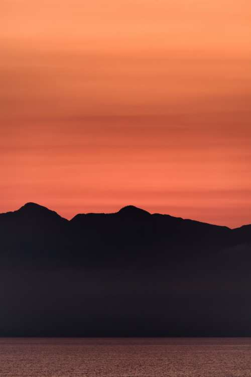 mountain sunset sky water silhouette