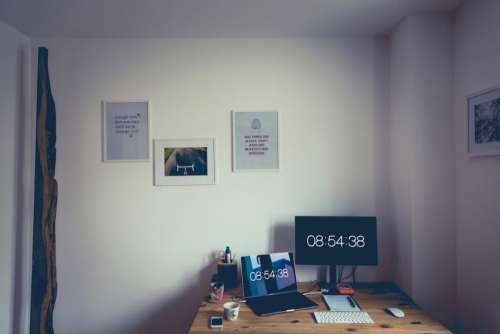 room office desk screens laptop
