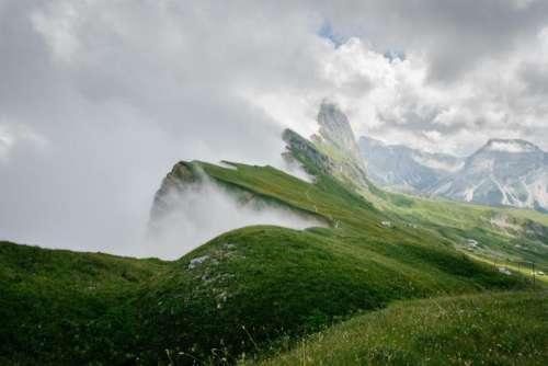 green grass highland grassland clouds