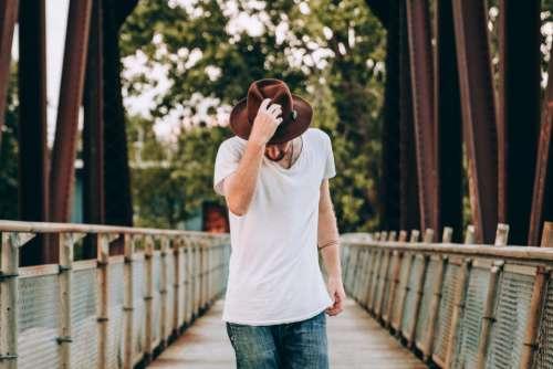 man bridge outdoors hat casual