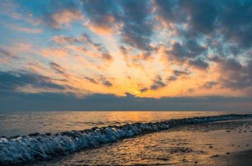 sunset dusk sky clouds ocean