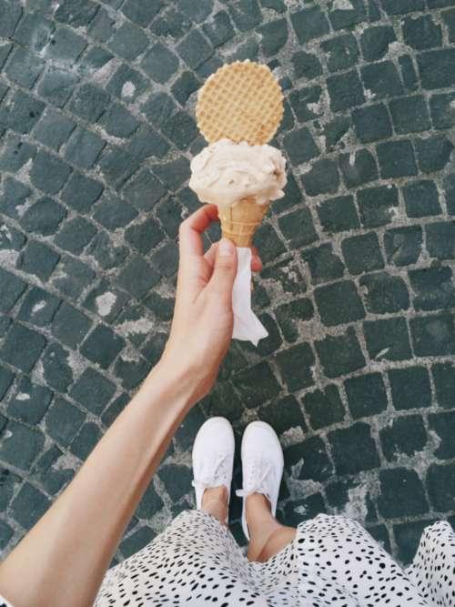woman holding ice cream street summer
