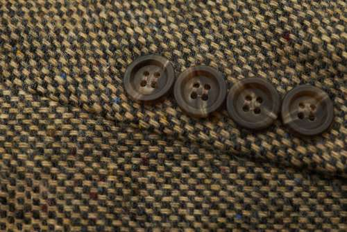 tweed suit buttons coat closeup