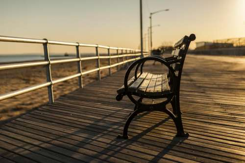 bench boardwalk wood beach sand