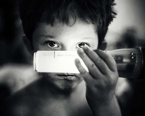 black and white kid child boy flashlight