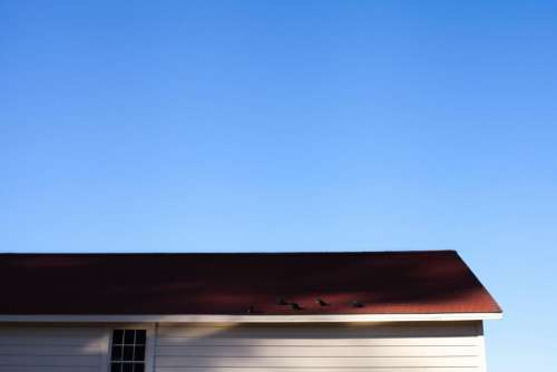 aerial house building roof blue