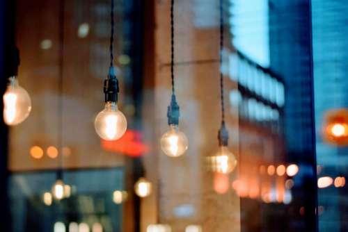 light bulb electricity buildings blur