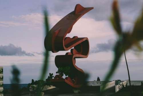 art sculpture red sky clouds