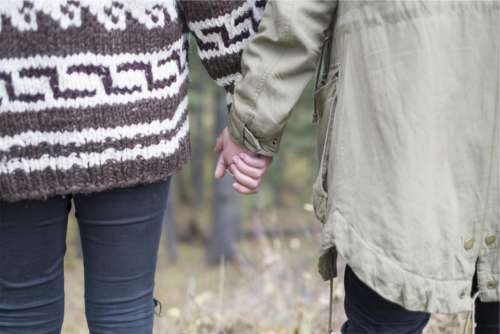 couple love holding hands people romance