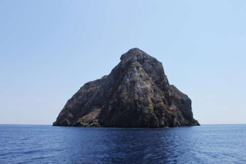 cliff island rock horizon sea