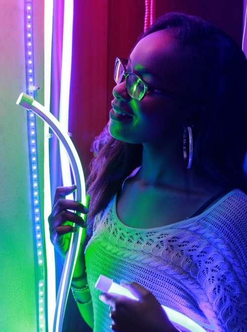 woman neon lights smiling happy