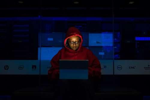 woman coding dark night hoodie