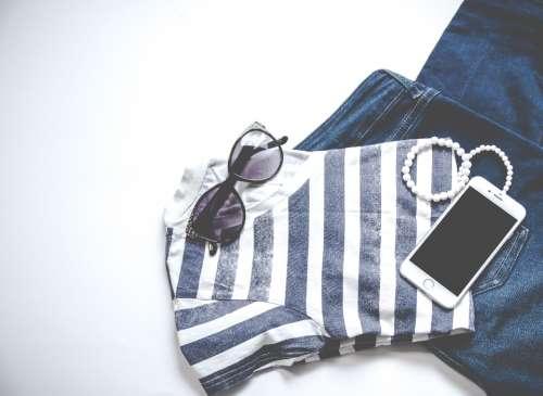 sunglasses jeans mobile device smartphone