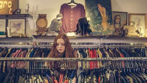 woman shopping clothes store browse