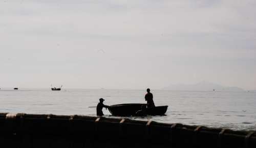 fishing boat man men shadow