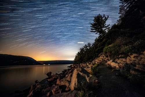 night sky star trails landscape rocks