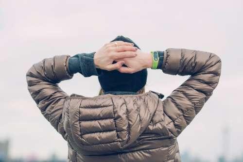 woman hands head smart watch
