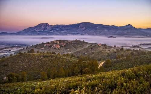 nature landscape mountains fog sunrise