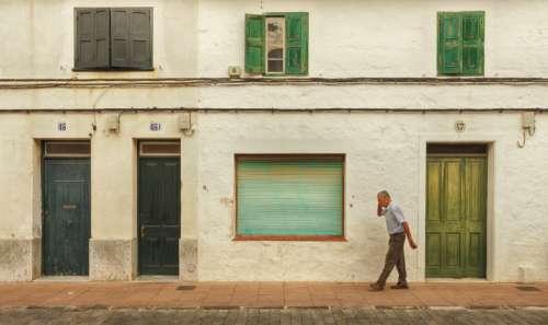 old man walking street city
