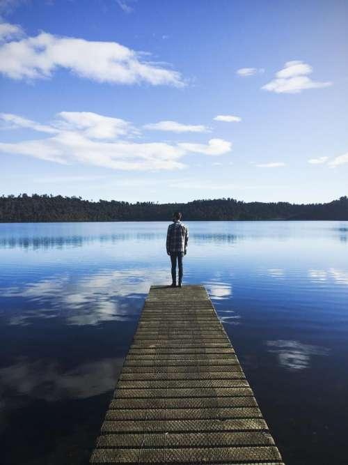 dock pier lake water guy