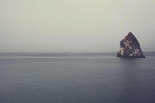 ocean sea water rock sky