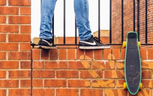 bricks wall brickwork people sneakers