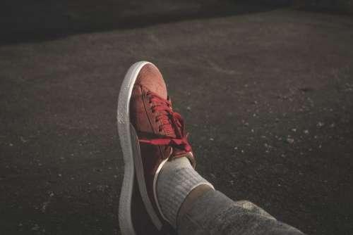 red sneakers shoe socks footwear