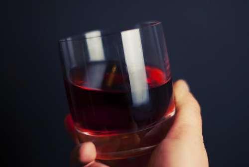 glass juice drink hand