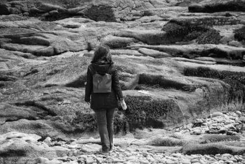 black and white people girl walking alone
