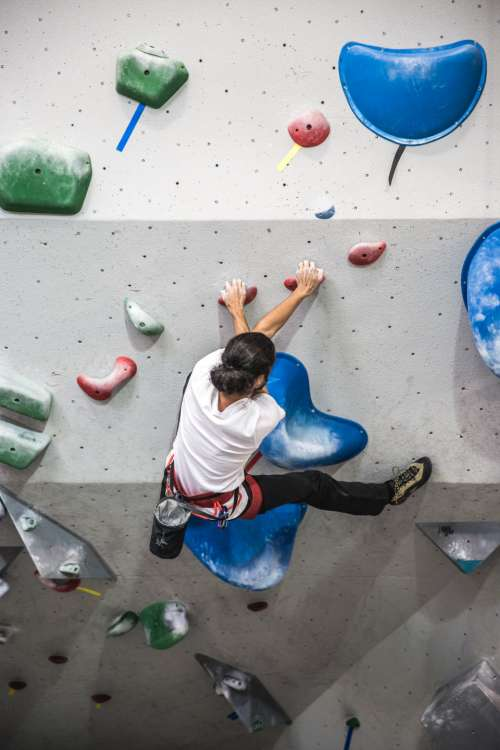 rock climb wall indoors man person