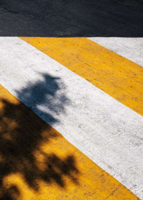 pedestrian lane shadow white yellow