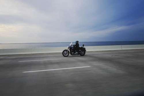 horizon people riding driving motorcycle