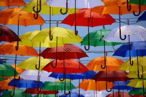 umbrella rain blue yellow red
