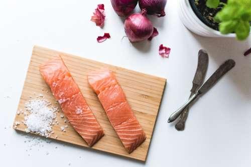salmon filets salt cutting board kitchen