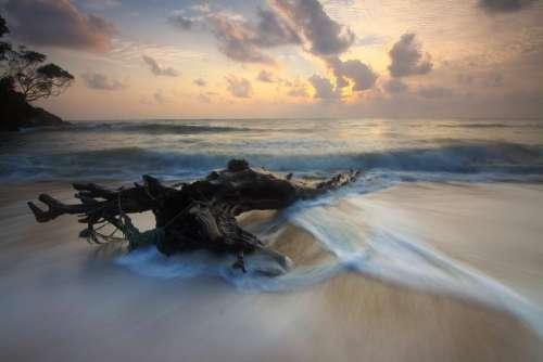 beach sand sea ocean water